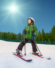 Little skier in mountain sky resort
