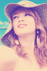 Woman with hat at the beach-color filters