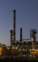An oil refinery at sunset