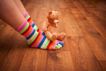 teddy bear sits on legs