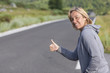 woman hitchhiking