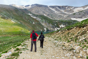 Couple of travelers walking on a trail in Uludag Mountains