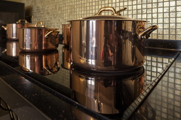 Copper cookware on the stove