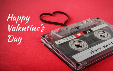 Vintage audio cassette with loose tape shaping a heart