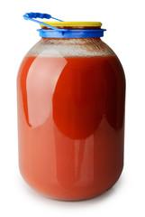 Jar with tomato juice isolated on white