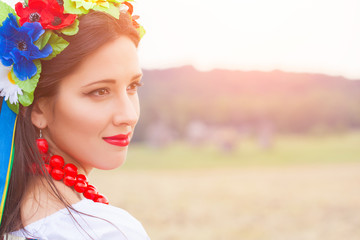beautiful young woman wearing national ukrainian clothes posing