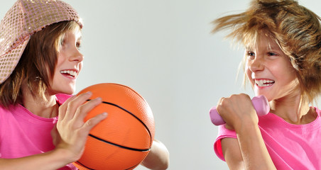 children exercising with dumbbells and ball