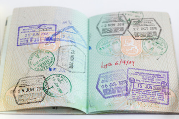 Closeup of an open passport with many stamps
