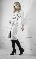 Fashion model in white suit