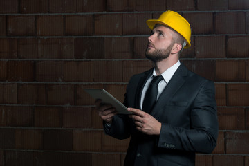 Portrait Of Young Construction Manager With Personal Computer
