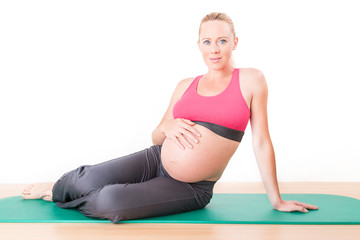 Pregnant woman doing natal exercises