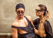 Sexy and fashionable couple wearing jeans, sunglasses. Vogue