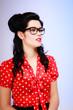 Retro. Portrait of pinup girl in eyeglasses