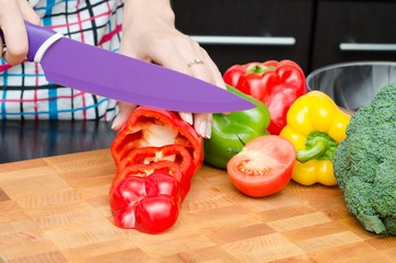 Cook preparing food, cut the peppers into slices