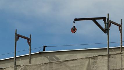 Building activity. Construction site with crane.