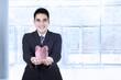 Asian businessman with piggy bank