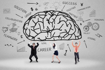Business team holding a brain 1