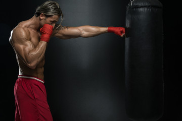 Attractive Man With Boxing Bag