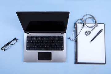 Computer laptop, stethoscope and clipboard 1