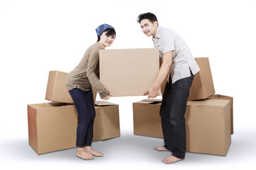 Couple unpacking cardboard in new home 2