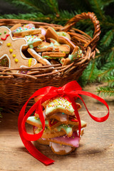 Preparing gingerbread cookies as a gift on old wooden table