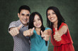 Group of students showing thumbs up 4