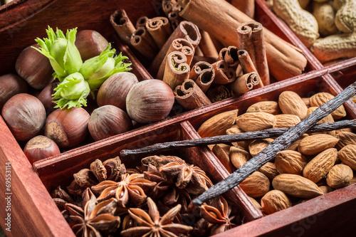 Zdjęcia na płótnie, fototapety na wymiar, obrazy na ścianę : Closeup of ingredients and nuts for chocolate