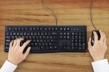 Hands typing on keyboard with mouse 1