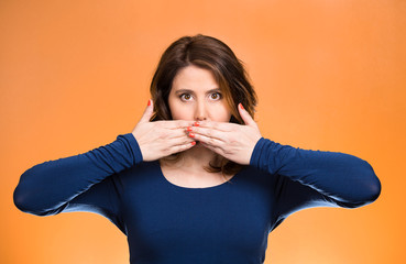 Woman covering closed mouth. Speak no evil concept
