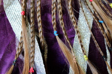 girl's plaits on the fabric pattern