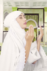 Muslim woman praying in mosque 2