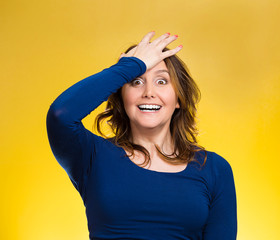 Woman placing hand on head palm on face gesture in duh moment