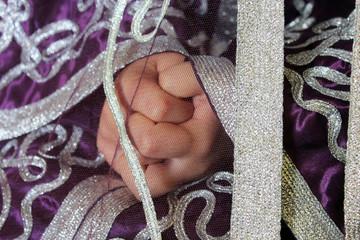 girl's hands in Moroccan suit