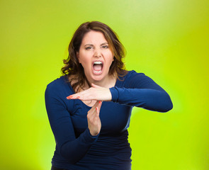 Screaming woman, showing timeout gesture with hands