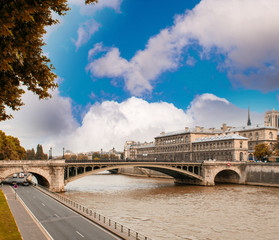 Notre Dame Bridge in Paris with Seine river and city traffic