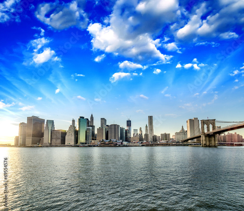 New York City. Wonderful sunset view of Brooklyn Bridge and Manh - 69554576