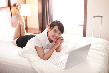 business travel woman with laptop