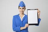Charming Stewardess Dressed In Blue Uniform with empty blank in