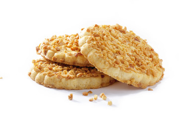 stack of cookies with walnut crumbs close-up on white background