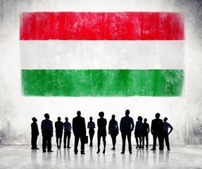 Silhouettes of Business People and Flag of Hungary