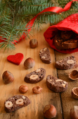 Christmas decoration with chocolate biscotti, hazelnuts and pine
