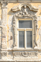 Fragment of ancient building with stucco moulding