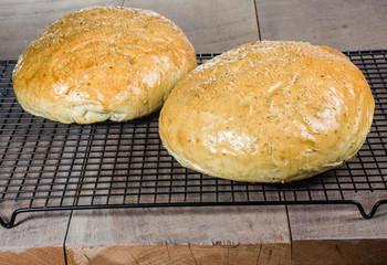 Artisan rosemary bread on cooling rack