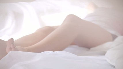 Close-up of woman in pajamas lying in bed