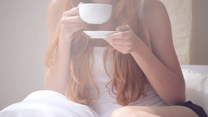 Woman in pajamas drinking coffee
