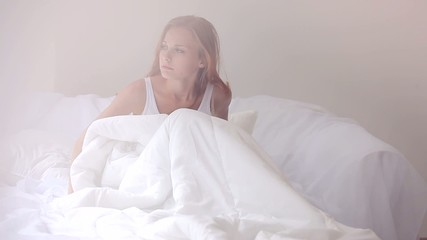 Woman in bedroom during morning