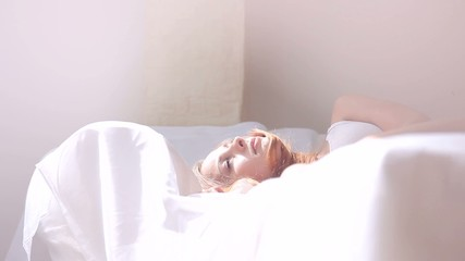 Woman waking up during sunny morning