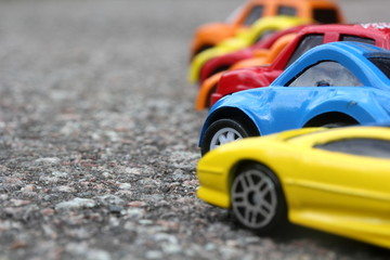 miniature colorful cars standing in line on road sale concept
