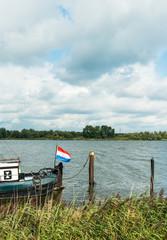 Dutch flag on the back of an historic ship