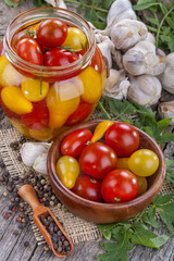 canned and preserved domestic tomato on an old rustic table